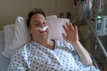 Dave Mozeleski waves at the camera after undergoing a major sinus procedure at Chestnut Hill Hospital in 2010. (Photo courtesy of Jennefer Mozeleski)
