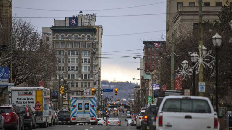 An ambulance drives in downtown Scranton.