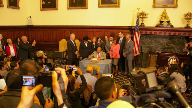 Mayor Michael Nutter signs an executive order  that ended ICE detainers as long as the person being released has no first or second degree felonies. (Nathaniel Hamilton/For Newsworks)