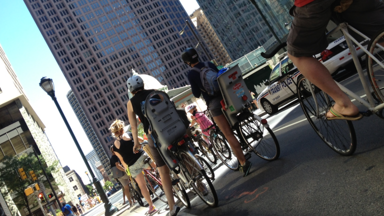 People bike together through Philadelphia. (Dena Driscoll/for NewsWorks)
