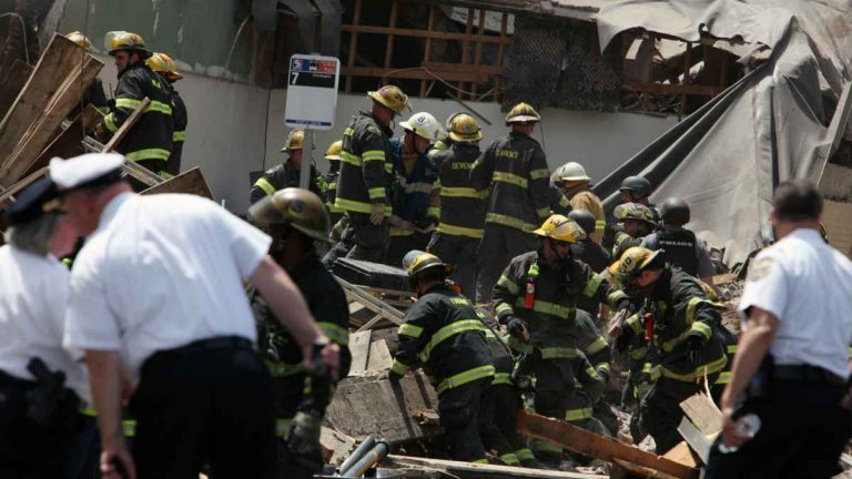 Rescue personnel search the scene of the building collapse in downtown Philadelphia on June 5. (AP Photo/Jacqueline Larma)