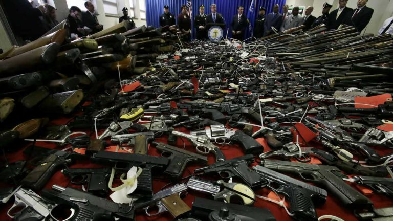 Guns cover tables in Camden, N.J., Tuesday, Dec. 18, 2012. (Mel Evans/AP Photo, file)