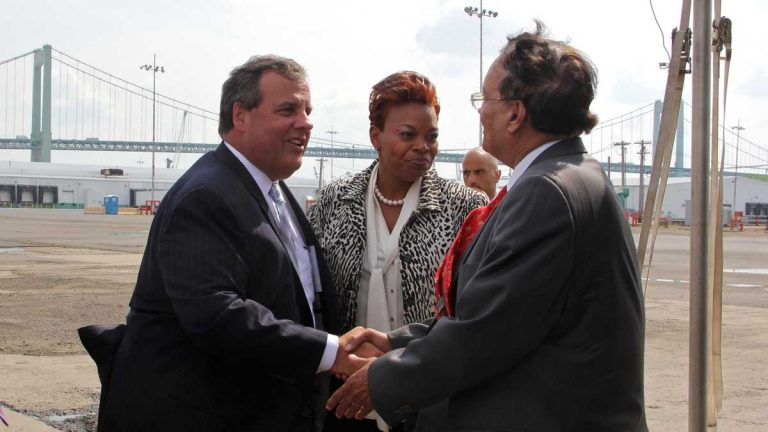 Gov. Chris Christie and Camden Mayor Dana Redd greet Krishna Singh, president of Holtech, who says he will bring jobs to Camden in exchange for up to $260 million in tax incentives. (Emma Lee/WHYY)