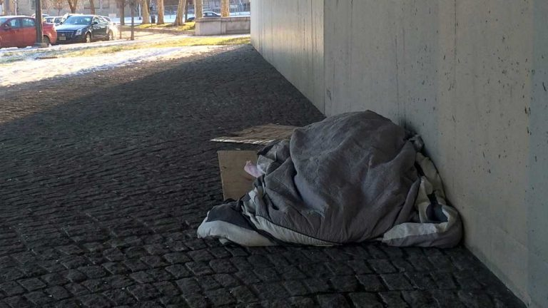 Taking shelter under the I-676 overpass. (Emma Lee/WHYY)
