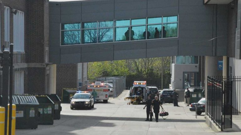 Paramedics walk outside Howard High School after a student was killed inside on April 21st. (File/WHYY)