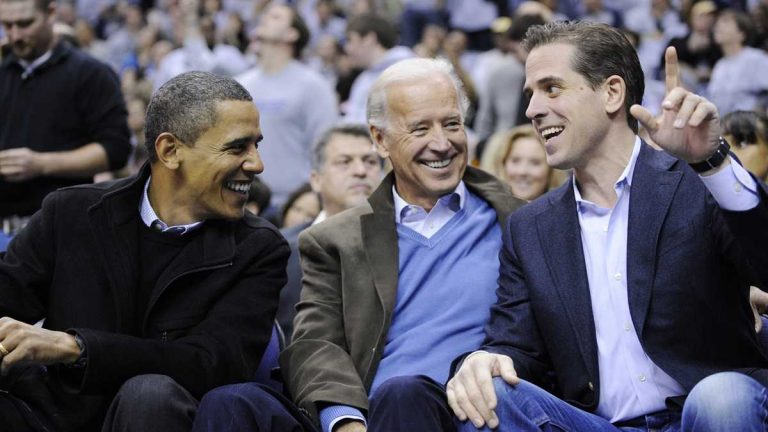 President Barack Obama talks with Vice President Joe Biden and his son Hunter Biden at the Duke Georgetown NCAA college basketball game