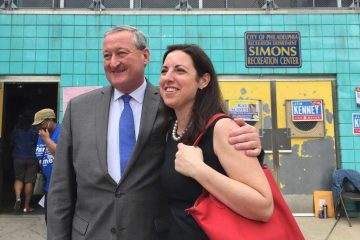 Mayoral candidates Jim Kenney and Melissa Murray Bailey stood side-by-side outside a polling place during May's primary election. (Brian Hickey/WHYY)