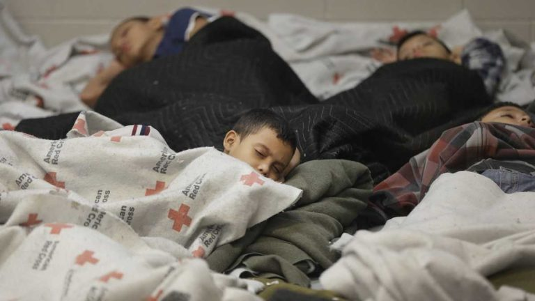 Young detainees sleep in a holding cell at a U.S. Customs and Border Protection processing facility in Brownsville