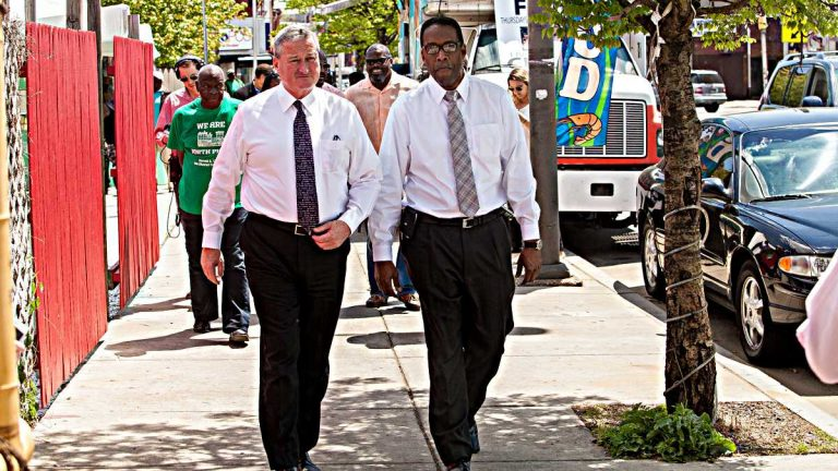 Mayoral candidate Jim Kenney (left) and City Council President Darrell Clarke tour North Philadelphia. (Brad Larrison/for NewsWorks)