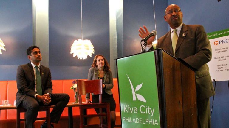 Mayor Michael Nutter announces a new initiative, Kiva City Philadelphia, that will provide interest-free loans to small businesses. At left is Kiva President Premal Shah. (Emma Lee/WHYY)