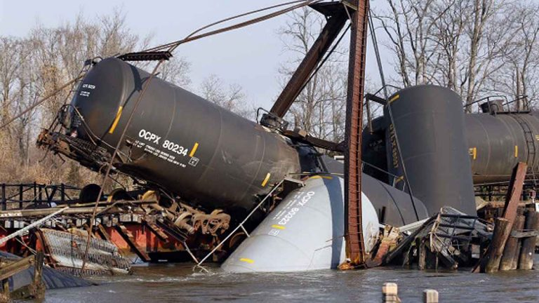 Freight train tank cars that derailed in Nov 2012 are seen in Mantua Creek in Paulsboro, N.J. (AP Photo/Mel Evans)
