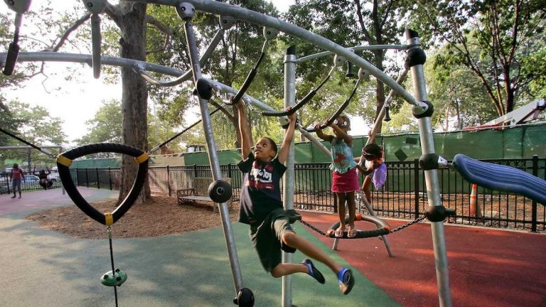 Children enjoy the warm weather in the playground at Franklin Square in Philadelphia. Friday will be another