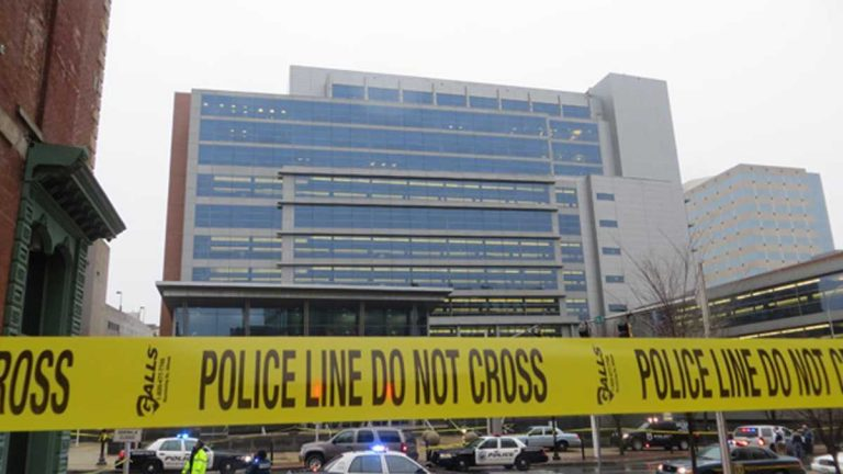 Police gather outside the New Castle County Courthouse in 2013 after two people were shot and killed by Thomas Matusiewicz. His relatives go on trial later this year for their alleged role in planning the attack. (File/WHYY)