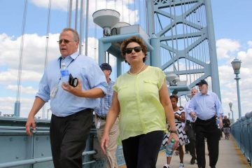 After parking in Camden, pilgrims can take the ferry, PATCO or walk across the Ben Franklin Bridge. (Emma Lee/WHYY)