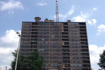 The Queen Lane Apartments tower will now be imploded one day earlier than scheduled. (Brian Hickey/WHYY)