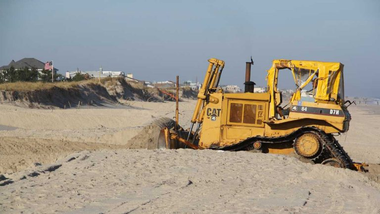 A bulldozer on Long Beach Island moves sand to restore the dunes that were swept away by Hurricane Sandy. (Emma Lee/for NewsWorks, file)