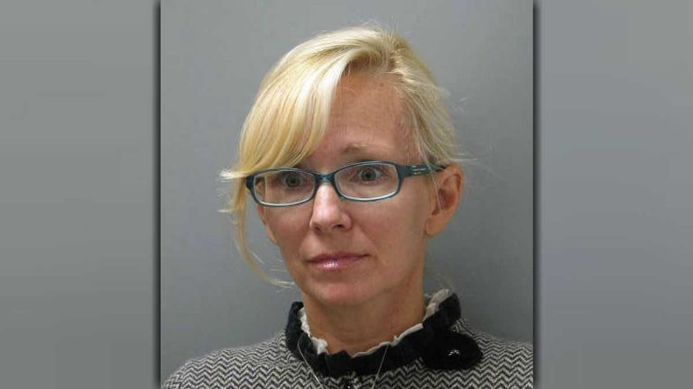 In this undated photo provided Wednesday, Nov. 5, 2014 by the Delaware State Police, Molly Shattuck, of Baltimore, poses for a police mug shot. Shattuck, 47, a former Baltimore Ravens cheerleader and the estranged wife of a prominent Maryland energy executive has been arrested and charged in connection with a sexual relationship involving a 15-year-old boy. Shattuck was indicted Monday, Nov. 3, 2014, on two counts of third-degree rape, four counts of unlawful sexual contact and three counts of providing alcohol to minors. (AP Photo/Delaware State Police)