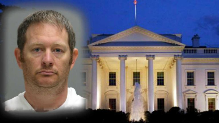 This booking photo provided by the Delaware Department of Justice shows Lee Robert Moore. Federal authorities say Moore, a Secret Service agent from Maryland, sent obscene images and texts to someone he thought was a young Delaware girl, sometimes doing it while on duty at the White House. (Delaware Department of Justice via AP)
