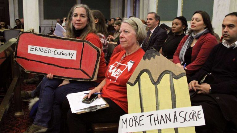 Education activists Allison McDowell (left) and Diane Payne attend hearings at City Council to express their objections to standardized testing in November 2014. (Emma Lee/WHYY)