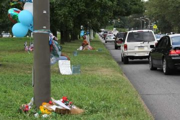 Memorials mark the area of Roosevelt Boulevard near 2nd Street where Samara Banks and three children were killed as they attempted to cross Roosevelt Blvd., a 12-lane roadway. (Emma Lee/WHYY, file)