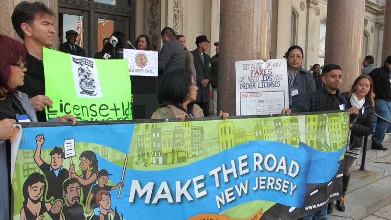 Advocates on steps of the New Jersey Statehouse urge support for a measure that would expand driving privileges to immigrants. (Phil Gregory/for NewsWorks)
