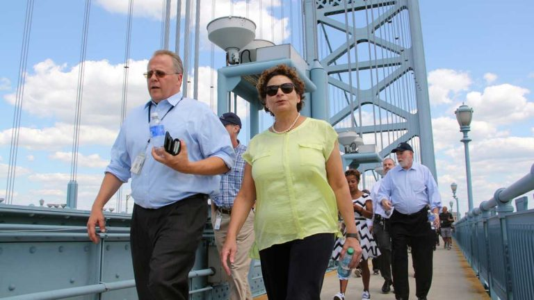 NJ Transit Executive Director Ronnie Hakim (center) crosses the Ben Franklin Bridge while walking the route she expects riders to take from Camden to the Ben Franklin Parkway, wher Pope Francis will celebrate Mass with up to 1.5 million people. (Emma Lee/WHYY)