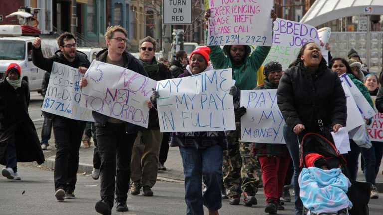 Protesters rally for higher wages and a union for fast food workers during a protest in front of the Broad Street McDonald's at Girard Avenue in March 2014. (Emma Lee/WHYY)