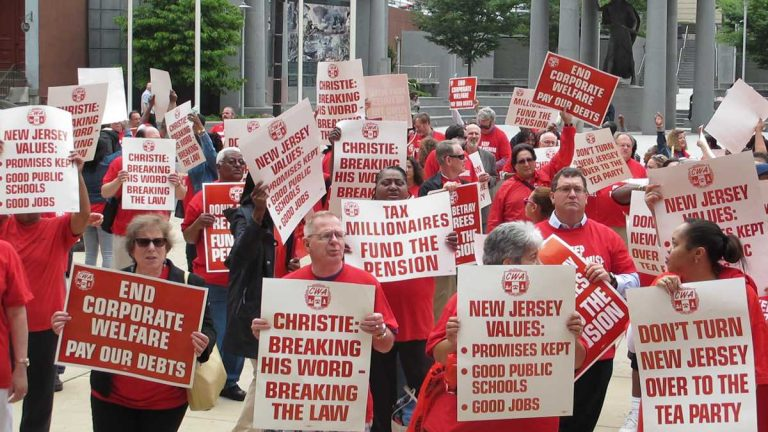 Unionized public workers rally outside the New Jersey Statehouse (Phil Gregory/WHYY)