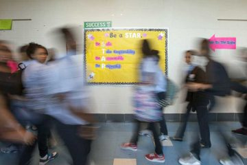 Middle school students change classes in Philadelphia. (Jessica Kourkounis/WHYY)
