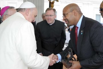 In this picture made available by the Vatican newspaper L'Osservatore Romano, Pope Francis shakes hands with Mayor of Philadelphia Michael Nutter, at the Vatican, Wednesday, March 26, 2014. (AP Photo/L'Osservatore Romano)