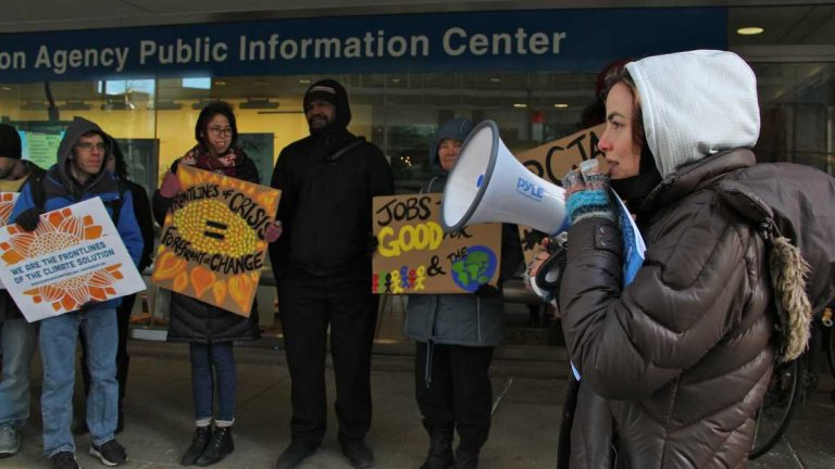 Demonstrators from the Climate Justice Alliance are shown rallying outside the Environmental Protection Agency in Center City in January 2016. (Emma Lee/WHYY)