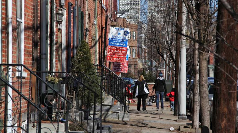 Homes are advertised for sale on Second Street in Philadelphia's Queen Village neighborhood. (Emma Lee for NewsWorks