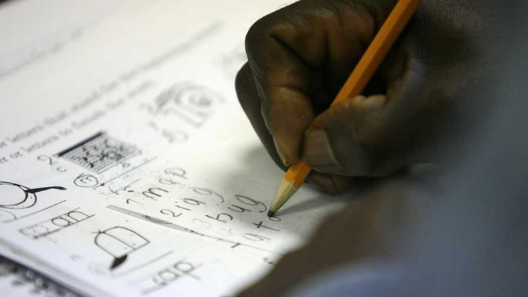 In this file image, an older student refugee from Tanzania completes a spelling exercise. (AP File Photo/Ed Zurga)