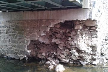The impact of Hurricane Sandy and flooding in the subsequent weeks damaged the foundation of the bridge. (photo courtesy DNREC)
