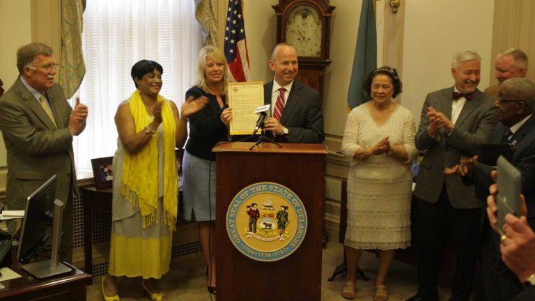 Gov. Jack Markell signed SB 191 in 2014