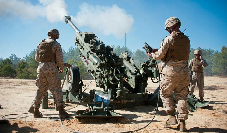 Marines from Golf Battery 3rd Battalion, 14th Marine Regiment, conduct artillery training May 4, 2013, on the Joint Base McGuire-Dix-Lakehurst ranges. The unit conducted 155 mm artillery training using their primary weapon system, M777A2 howitzer. (Photo: U.S. Air Force Staff Sgt. David Carbajal)