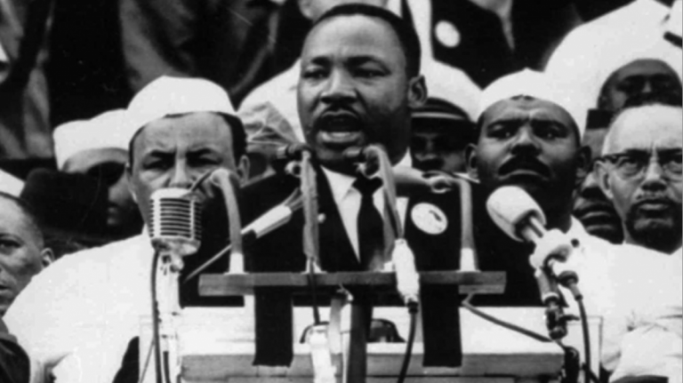 In this Aug. 28, 1963 file photo, Dr. Martin Luther King Jr., head of the Southern Christian Leadership Conference, addresses marchers during his