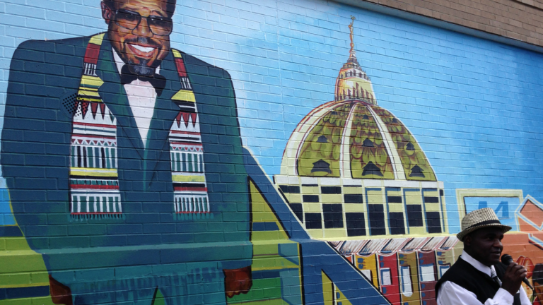 The Northwest Raiders and Mt. Airy Bantams are collaborating to raise money to build new facility. It would be named after late state Rep. David Richardson, shown here in a Chelten Ave. mural. (Brian Hickey/WHYY)