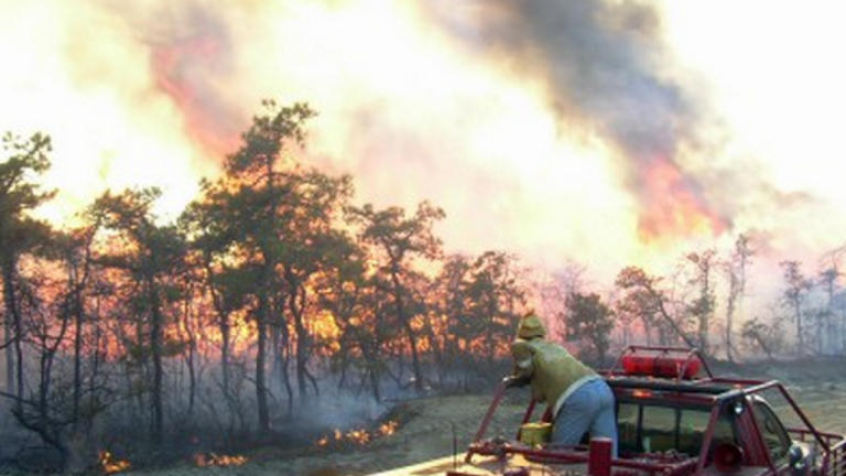 A firefighter on the scene of a fire at Warren Grove in southern Ocean County in 2004. (Photo: New Jersey Forest Fire Service)