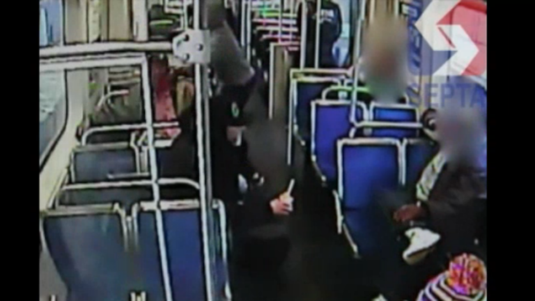 SEPTA surveillance video from Oct. 26 shows a man run up and punch a passenger on the Market Frankford train. (Courtesy of NBC10)