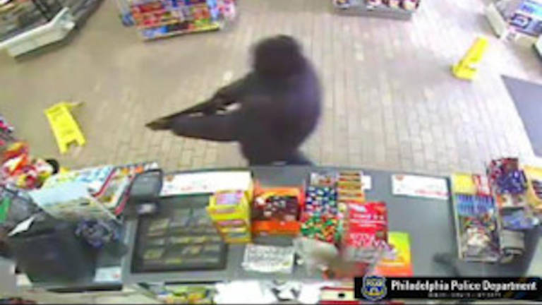 Surveillance footage from March, when a man used a sawed-off shotgun to rob a Stenton Avenue convenience store. (Photo courtesy of the Philadelphia Police Department)