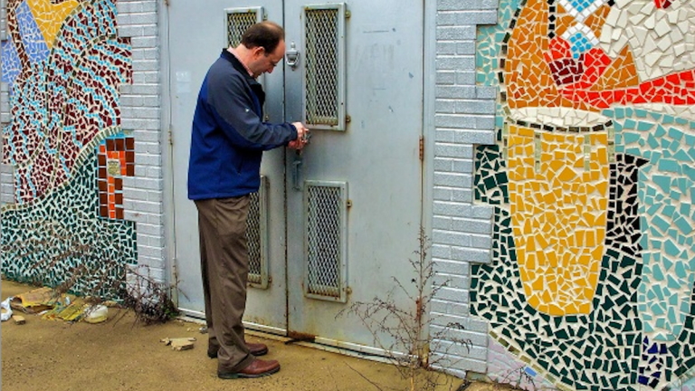 During a March 2012 tour of the property, Ken Weinstein was outside the former Germantown Settlement Charter School's Creative & Performing Arts Center. (Bas Slabbers/for NewsWorks)