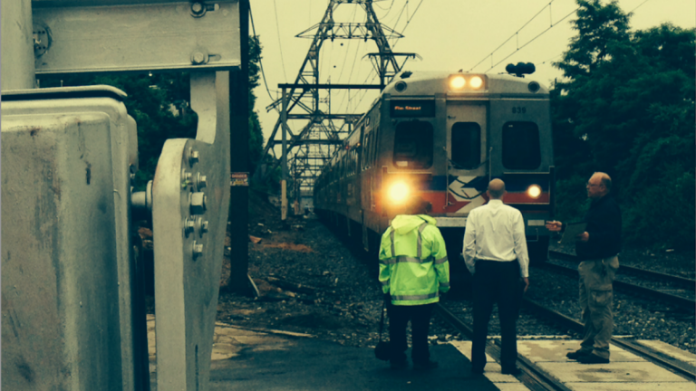 Investigators at the scene of Monday morning's suicide-by-train in East Falls. (Brian Hickey/WHYY)