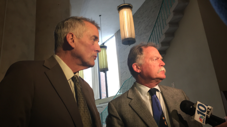 Don Tollefson (left) did not walk out of the Bucks County courthouse after being sentenced to state prison on Wednesday. On the first day of the trial, he fielded questions with court-appointed attorney Robert Goldman. (Brian Hickey/WHYY)