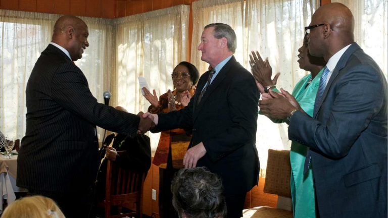 State Rep. Dwight Evans, who ran for mayor eight years ago, shakes Jim Kenney's hand at an April 6 endorsement event in West Oak Lane. (Bastiaan Slabbers/for NewsWorks)
