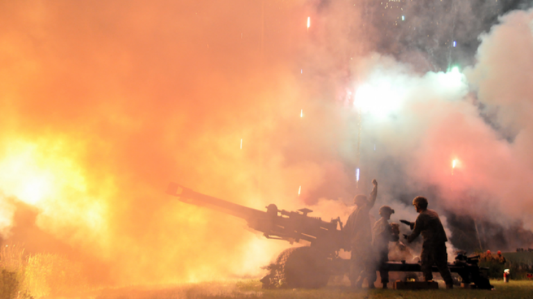 Soldiers from the Wisconsin Army National Guard's 1st Battalion, 120th Field Artillery fire powder charges from a M119A2 towed 105-mm howitzer on July 2, 2011. (Wisconsin National Guard photo by 1st Sgt. Vaughn R. Larson)