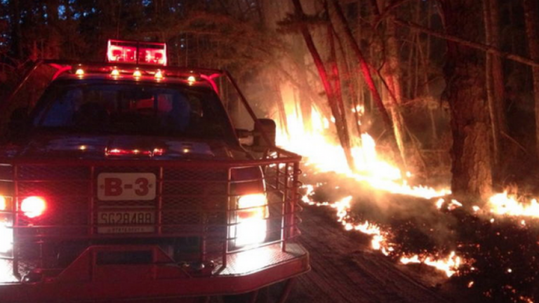A New Jersey Forest Fire Service truck on the scene of the 'Devious Mount' wildfire in Wharton State Forest in early April 2014. Crews contained the forest fire
