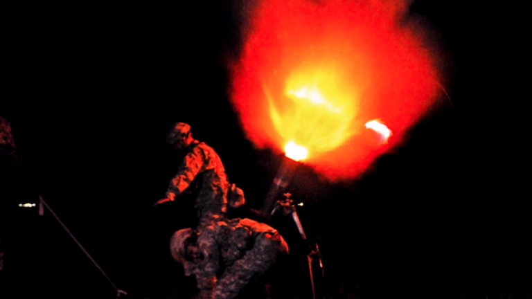 Soldiers fire a round from a 120mm illumination mortar system during a night training mission on Camp Santiago Joint Maneuver Training Center in Salinas, Puerto Rico, on July 14, 2013. (Photo: U.S. Army Staff Sgt. Joseph Rivera Rebolledo)