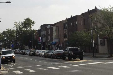Vehicles are parked in the median of South Broad Street in Philadelphia