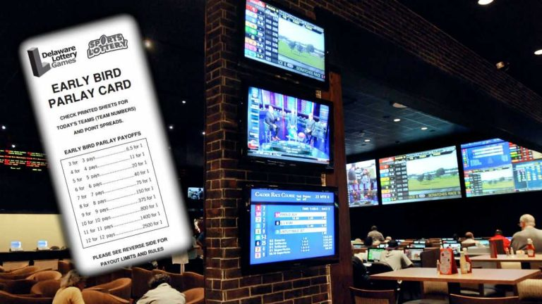 Bettors watch horse races at the sports book parlor at Dover Downs casino in Dover. (AP Photo/ Steve Ruark)